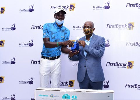 L-R: Mr. Tajudeen Ajayi, winner of the 59th FirstBank sponsored Lagos open golf championship receiving the award from Mr. Olusegun Alebiosu, Chief Risk Officer, FirstBank and representative of the Bank's CEO at the prize presentation and award night of the 59th edition of the annual FirstBank sponsored golf tourney, recently held at the Ikoyi Club, Lagos.