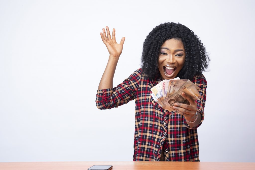 young black lady celebrating high-interest savings account